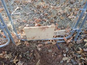 boards screwed to fencing, screws exposed