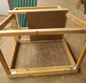 a half built rabbit tractor-hutch thing